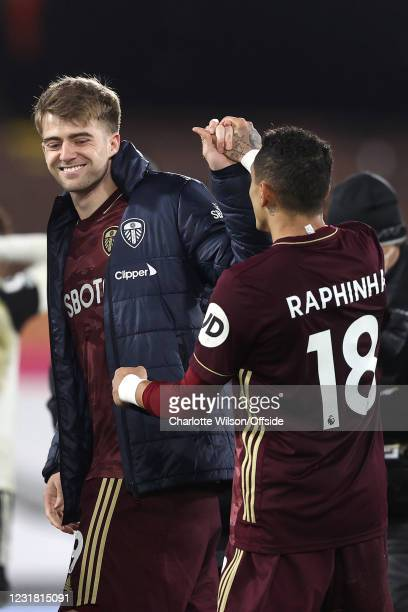Goalscorers Patrick Bamford and Raphinha of Leeds celebrate after the match during the Premier League match between Fulham and Leeds United at Craven...