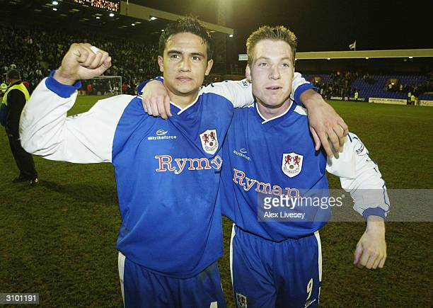 Goalscorers,Tim Cahill and Neil Harris of Millwall celebrate victory over Tranmere Rovers after the FA Cup Quarter-Final replay match between...