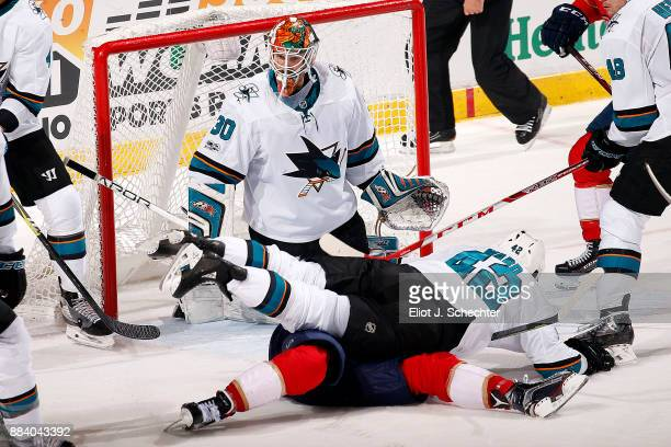 Goaltender Aaron Dell of the San Jose Sharks defends while teammate Joel Ward tangles with Aleksander Barkov of the Florida Panthers at the BBT...