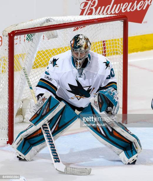 Goaltender Aaron Dell of the San Jose Sharks guards the net during third period action against the Winnipeg Jets at the MTS Centre on March 6 2017 in...