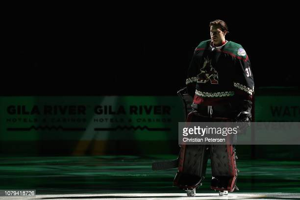 Goaltender Adin Hill of the Arizona Coyotes is introduced before the NHL game against the San Jose Sharks at Gila River Arena on December 8 2018 in...