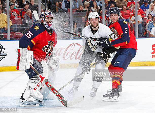 Goaltender Al Montoya and Steve Kampfer of the Florida Panthers defend against Bryan Rust of the Pittsburgh Penguins at the BBT Center on February 15...