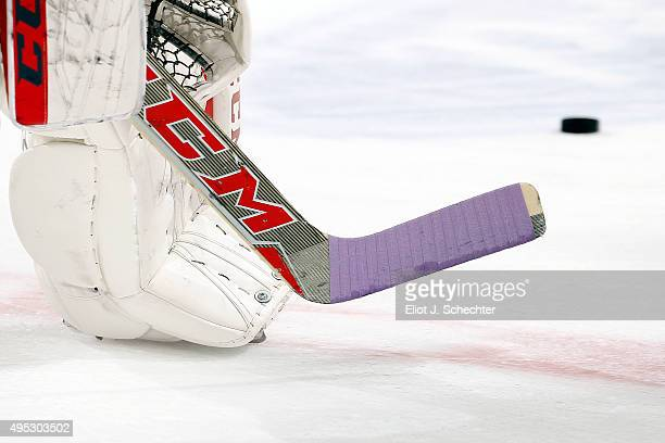Goaltender Al Montoya of the Florida Panthers has his hockey stick wrapped with purple tape on Hockey Fights Cancer night prior to the start of the...