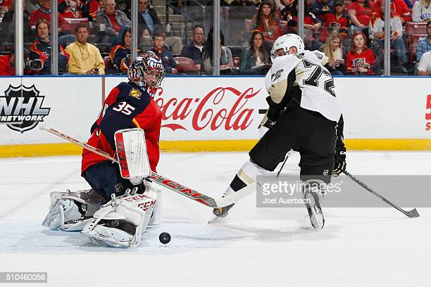 Goaltender Al Montoya of the Florida Panthers stops a shot by Patric Hornqvist of the Pittsburgh Penguins at the BBT Center on February 15 2016 in...