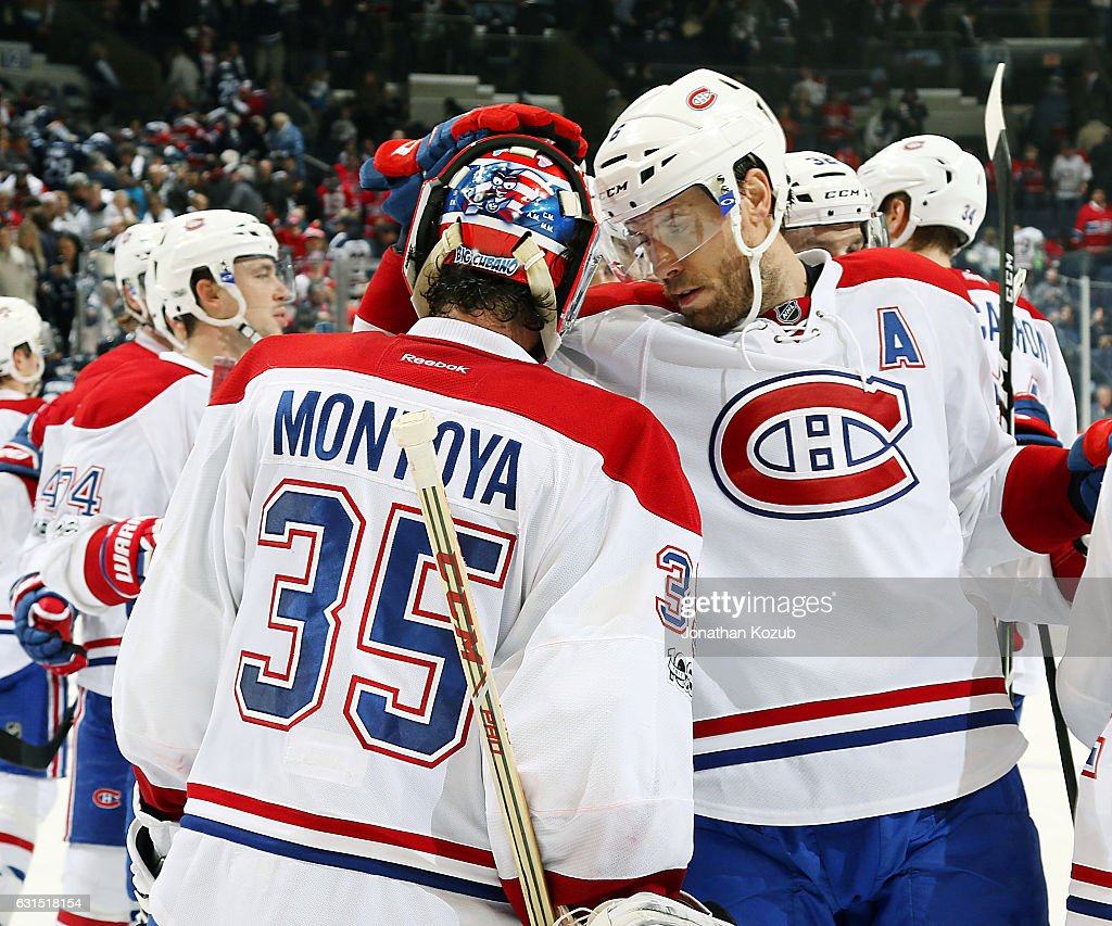 Goaltender Al Montoya #35 of the Montreal Canadiens gets congratulated by teammate Shea Weber #6 after backstopping the team to a 7-4 victory over the Winnipeg Jets at the MTS Centre on January 11, 2017 in Winnipeg, Manitoba, Canada.