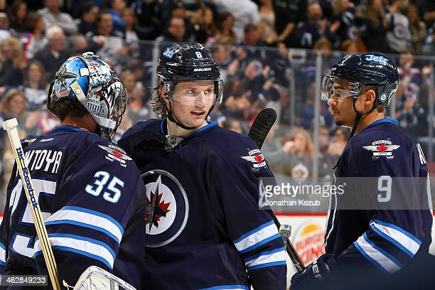 Goaltender Al Montoya of the Winnipeg Jets gets congratulated by teammates Jacob Trouba and Evander Kane after backstopping the Jets to a 30 victory...