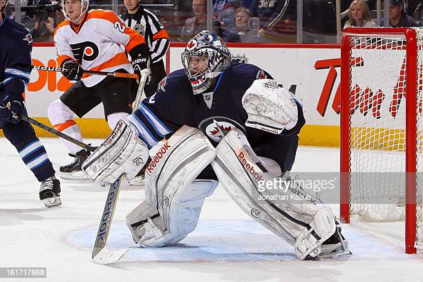 Goaltender Al Montoya of the Winnipeg Jets gets set in the crease during second period action against the Philadelphia Flyers at the MTS Centre on...