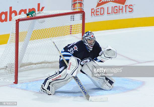 Goaltender Al Montoya of the Winnipeg Jets gets set in the crease during secondperiod action against the Detroit Red Wings at the MTS Centre on...