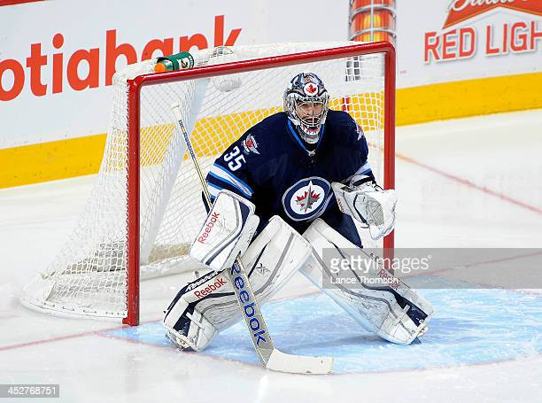 Goaltender Al Montoya of the Winnipeg Jets gets set in the crease during second period action against the Calgary Flames at the MTS Centre on...