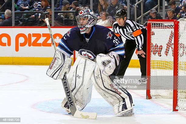 Goaltender Al Montoya of the Winnipeg Jets gets set in the crease during second period action against the Carolina Hurricanes at the MTS Centre on...