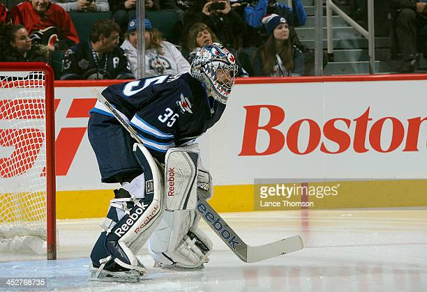 Goaltender Al Montoya of the Winnipeg Jets gets set in the crease prior to puck drop against the Calgary Flames at the MTS Centre on November 18 2013...
