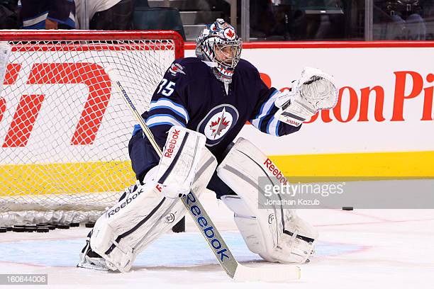 Goaltender Al Montoya of the Winnipeg Jets gets set to face shots from teammates during the pregame warm up prior to NHL action against the New York...