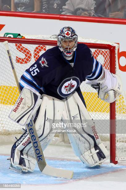 Goaltender Al Montoya of the Winnipeg Jets keeps an eye on the play during first period action against the New Jersey Devils at the MTS Centre on...