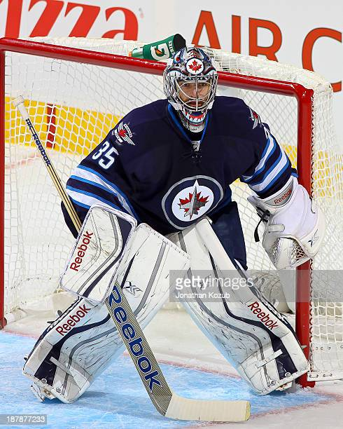 Goaltender Al Montoya of the Winnipeg Jets keeps an eye on the play during second period action against the Chicago Blackhawks at the MTS Centre on...