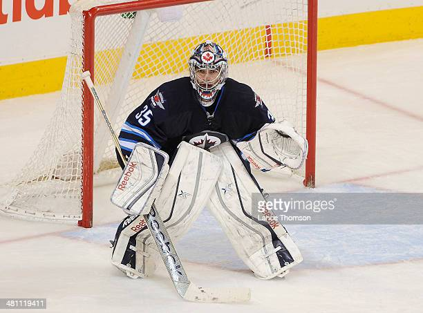Goaltender Al Montoya of the Winnipeg Jets keeps an eye on the play during second period action against the Colorado Avalanche at the MTS Centre on...
