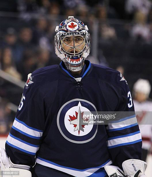 Goaltender Al Montoya of the Winnipeg Jets looks on before an NHL game against the New Jersey Devils at the MTS Centre on October 13 2013 in Winnipeg...