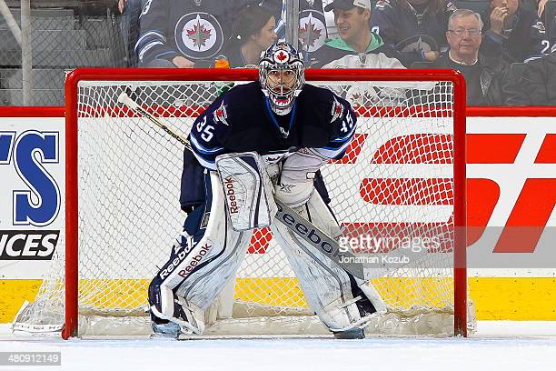 Goaltender Al Montoya of the Winnipeg Jets looks on from the crease during third period action against the Dallas Stars at the MTS Centre on March 16...