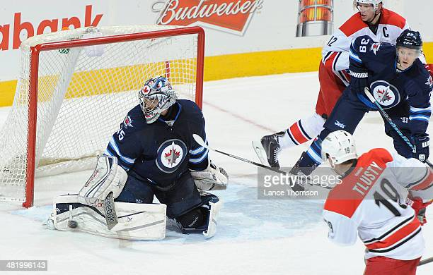 Goaltender Al Montoya of the Winnipeg Jets makes a pad save on Jiri Tlusty of the Carolina Hurricanes during second period action at the MTS Centre...