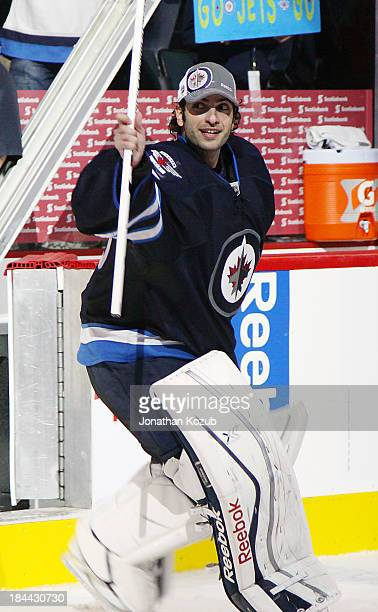Goaltender Al Montoya of the Winnipeg Jets salutes the fans after receiving first star honors after he backstopped the team to a 30 victory over the...