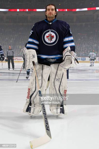 Goaltender Al Montoya of the Winnipeg Jets stands on the ice during the singing of 'O Canada' prior to puck drop against the Dallas Stars at the MTS...