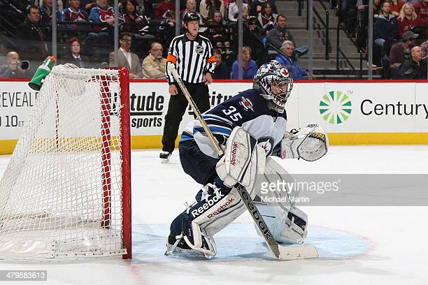 Goaltender Al Montoya of the Winnipeg Jets stands ready against the Colorado Avalanche at the Pepsi Center on March 10 2014 in Denver Colorado The...