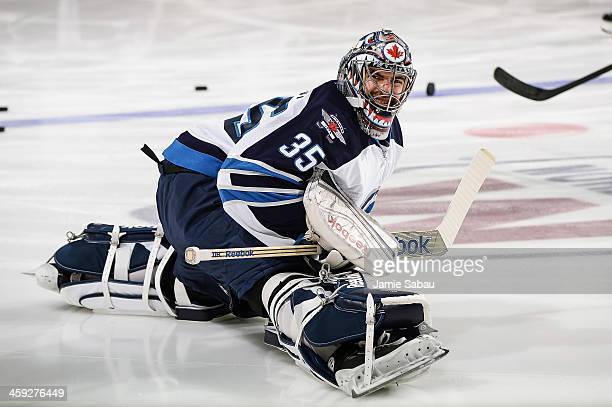 Goaltender Al Montoya of the Winnipeg Jets stretches before a game against the Columbus Blue Jackets on December 16 2013 at Nationwide Arena in...