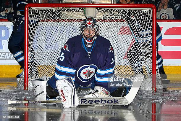 Goaltender Al Montoya of the Winnipeg Jets stretches in the crease prior to puck drop against the Carolina Hurricanes at the MTS Centre on March 22...