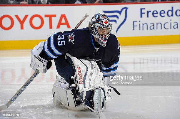 Goaltender Al Montoya of the Winnipeg Jets stretches on the ice before puck drop in third period action against the Buffalo Sabres at the MTS Centre...