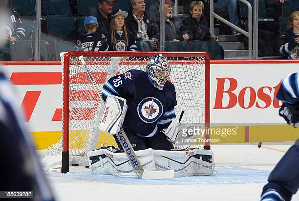 Goaltender Al Montoya of the Winnipeg Jets takes part in the pregame warm up prior to NHL action against the Montreal Canadiens at the MTS Centre on...