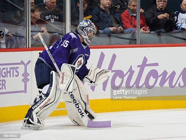 Goaltender Al Montoya of the Winnipeg Jets takes part in the pregame warm up sporting a lavender jersey in honor of the Hockey Fights Cancer...