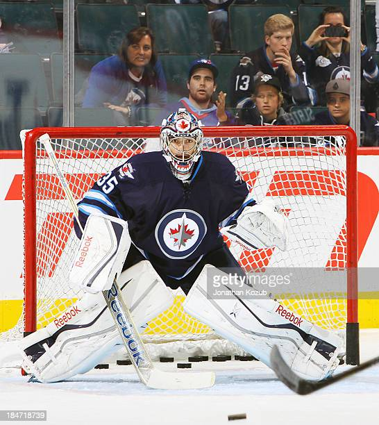 Goaltender Al Montoya of the Winnipeg Jets warms up prior to NHL action against the Anaheim Ducks at the MTS Centre on October 6 2013 in Winnipeg...