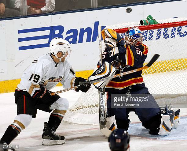 Goaltender Alex Auld of the Florida Panthers tangles with Andy McDonald of the Anaheim Ducks in the second period at the Bank Atlantic Center on...