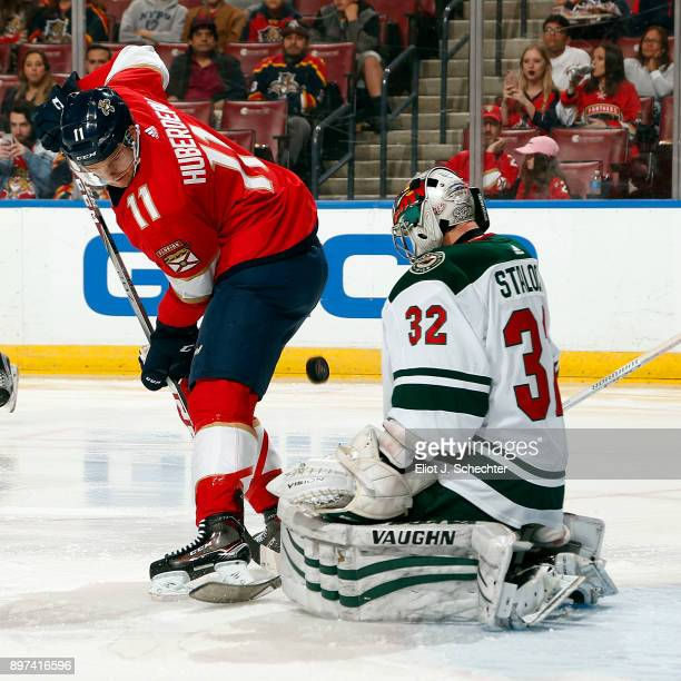 Goaltender Alex Stalock of the Minnesota Wild defends the net against Jonathan Huberdeau of the Florida Panthers at the BBT Center on December 22...
