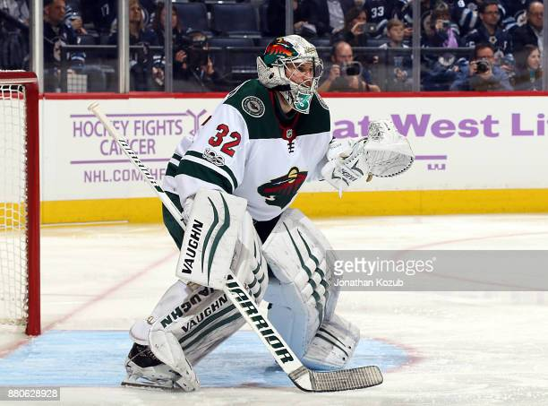 Goaltender Alex Stalock of the Minnesota Wild guards the net during second period action against the Winnipeg Jets at the Bell MTS Place on November...