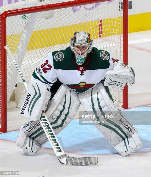 Goaltender Alex Stalock of the Minnesota Wild guards the net during third period action against the Winnipeg Jets at the Bell MTS Place on November...