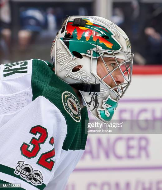 Goaltender Alex Stalock of the Minnesota Wild looks on during second period action against the Winnipeg Jets at the Bell MTS Place on November 27...