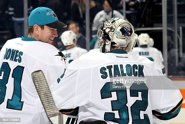 Goaltender Alex Stalock of the San Jose Sharks celebrates with teammate Martin Jones as they leave the ice following a 41 victory over the Winnipeg...