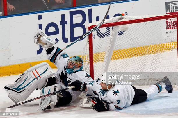 Goaltender Alex Stalock of the San Jose Sharks collides with teammate Brad Stuart against the Florida Panthers at the BBT Center on January 16 2014...
