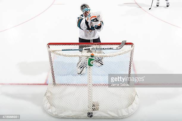 Goaltender Alex Stalock of the San Jose Sharks dons his blocker and glove before the start of a game against the Columbus Blue Jackets on March 13...