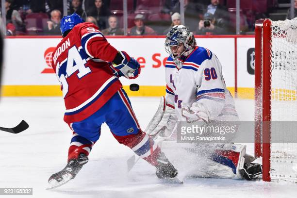 Goaltender Alexandar Georgiev of the New York Rangers defends his net in his first ever NHL game against Charles Hudon of the Montreal Canadiens...