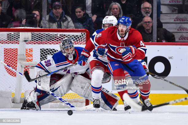 Goaltender Alexandar Georgiev of the New York Rangers protects his net during his NHL debut against Paul Byron of the Montreal Canadiens at the Bell...