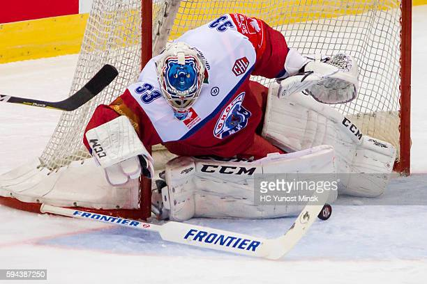 Goaltender Alexander Tryanichev of YunostMinsk stops the puck during the 2nd period of the Champions Hockey League group stage game between...