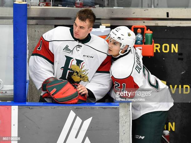 Goaltender Alexis Gravel and teammate Arnaud Durandeau of the Halifax Mooseheads look on from the bench against the BlainvilleBoisbriand Armada...