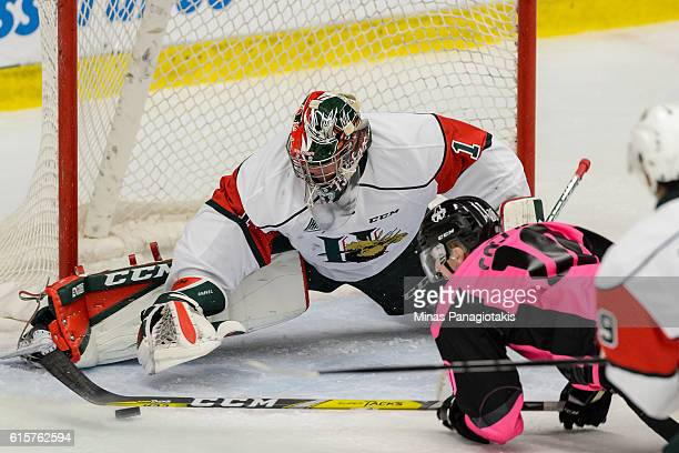Goaltender Alexis Gravel of the Halifax Mooseheads reaches for the puck during the QMJHL game against the BlainvilleBoisbriand Armada at the Centre...