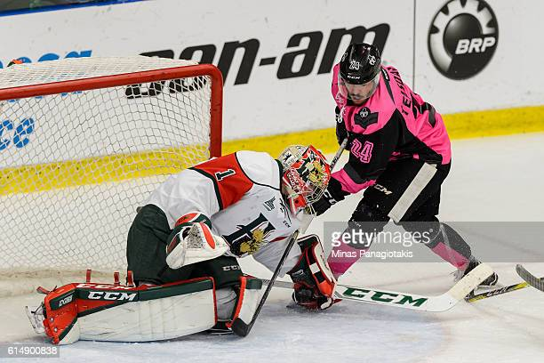 Goaltender Alexis Gravel of the Halifax Mooseheads stops Joel Teasdale of the BlainvilleBoisbriand Armada during the QMJHL game at the Centre...