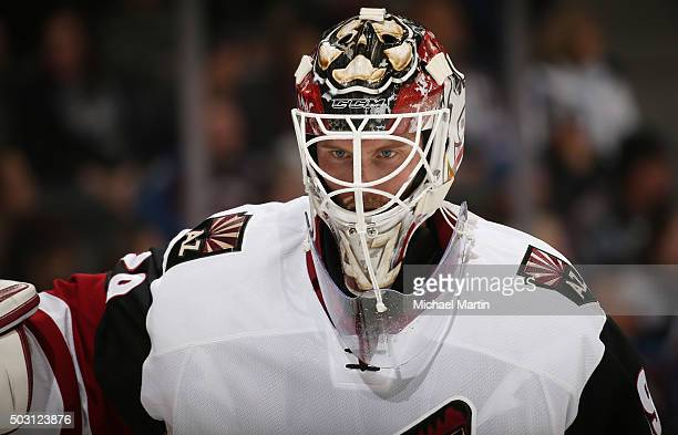 Goaltender Anders Lindback of the Arizona Coyotes skates against the Colorado Avalanche at the Pepsi Center on December 27 2015 in Denver Colorado...