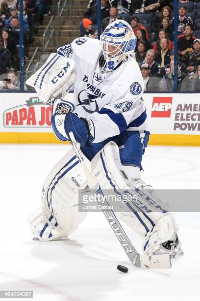 Goaltender Anders Lindback of the Tampa Bay Lightning skates with the puck against the Columbus Blue Jackets on January 13 2014 at Nationwide Arena...
