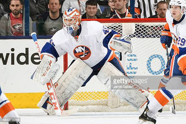 Goaltender Anders Nilsson of the New York Islanders defends the net against the Columbus Blue Jackets on April 6 2014 at Nationwide Arena in Columbus...