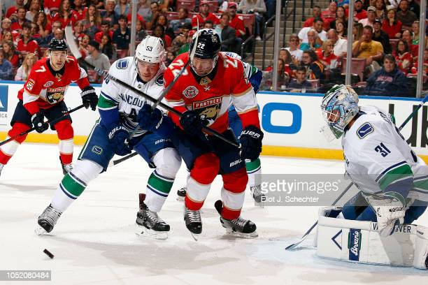 Goaltender Anders Nilsson of the Vancouver Canucks defends the net with the help of teammate Bo Horvat against Troy Brouwer of the Florida Panthers...