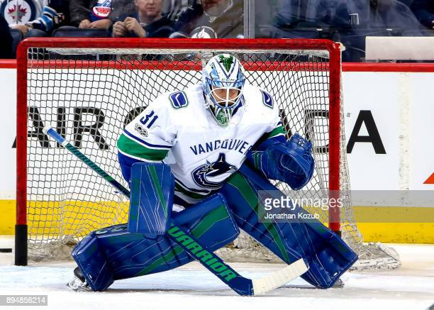 Goaltender Anders Nilsson of the Vancouver Canucks takes part in the pregame warm up prior to NHL action against the Winnipeg Jets at the Bell MTS...